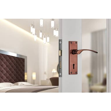 Sophia Lever on Backplate Key Hole Lock Door Handle - Rose Gold/Copper On A White Wooden Glass Door