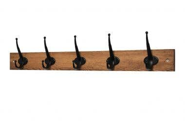 5 Vintage Black Traditional Hooks on Antique Wooden Board - main image